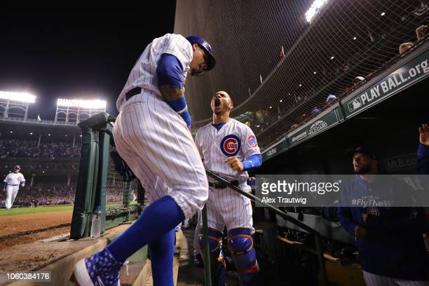 Javier Baez of the Chicago Cubs celebrates with Willson Contreras after hitting a game-tying RBI double in the eighth inning during the National...
