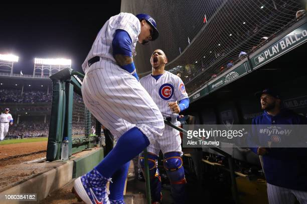 Javier Baez of the Chicago Cubs celebrates with Willson Contreras after hitting a gametying RBI double in the eighth inning during the National...