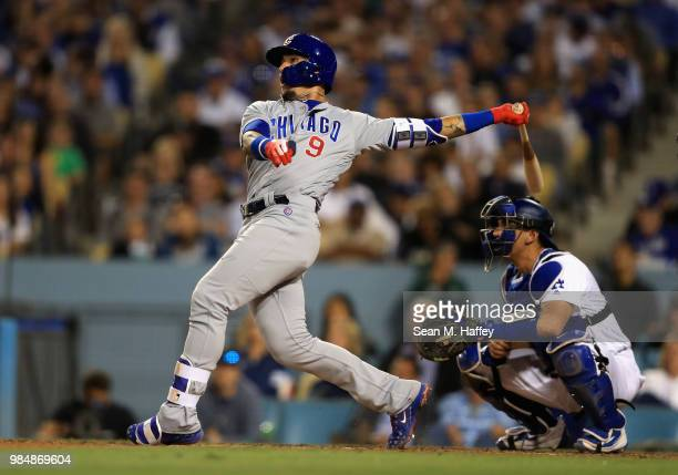 Javier Baez of the Chicago Cubs connects for a grandslam as Austin Barnes of the Los Angeles Dodgers looks on during the sixth inning of a game at...