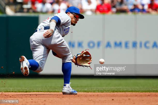 Javier Baez of the Chicago Cubs fields a the ball against the St Louis Cardinals in the second inning at Busch Stadium on June 2 2019 in St Louis...