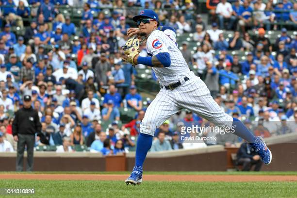 Javier Baez of the Chicago Cubs fields his position during the game against the Milwaukee Brewers on Monday October 1 2018 at Wrigley Field in...