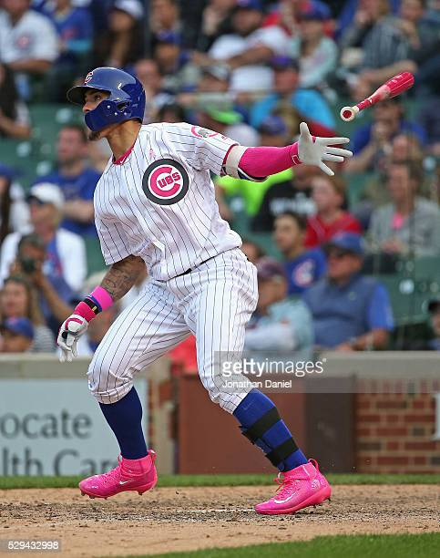 Javier Baez of the Chicago Cubs follows the flight of his gamewinning walk off home run against the Washington Nationals at Wrigley Field on May 8...