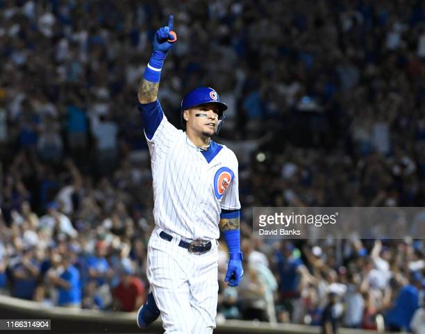 Javier Baez of the Chicago Cubs gestures as he runs the bases after hitting a tworun home run against the Oakland Athletics during the seventh inning...
