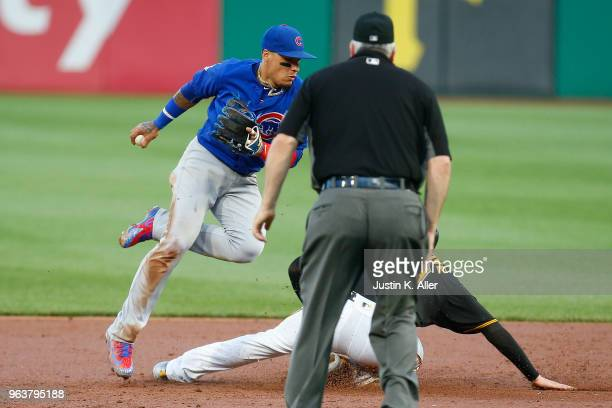 Javier Baez of the Chicago Cubs gets the force out at second as Joe Musgrove of the Pittsburgh Pirates slides in hard in the third inning at PNC Park...