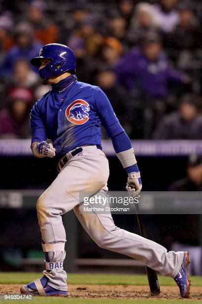 Javier Baez of the Chicago Cubs hits a 2 RBI single in the sixth inning against the Colorado Rockies at Coors Field on April 20 2018 in Denver...