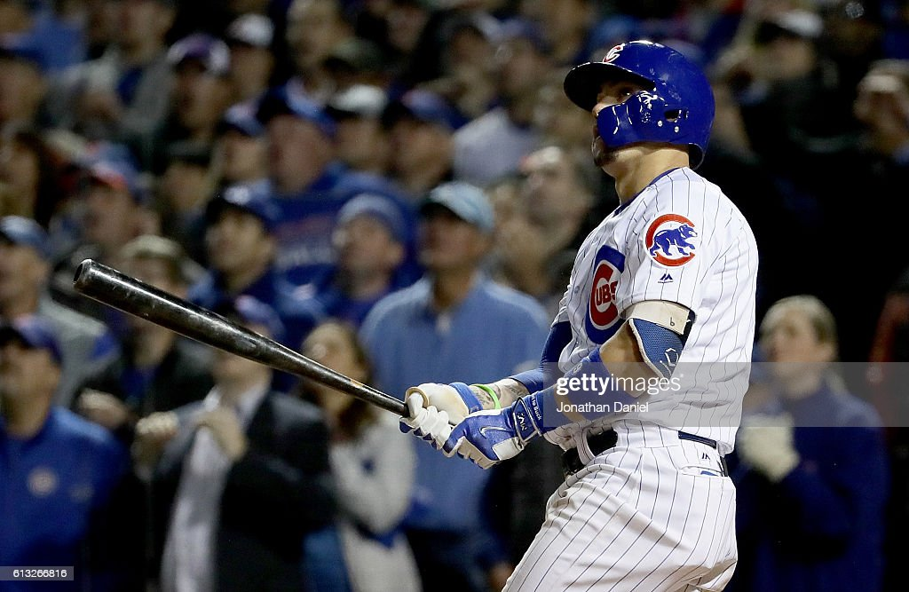 Javier Baez #9 of the Chicago Cubs hits a home run in the eighth inning against the San Francisco Giants at Wrigley Field on October 7, 2016 in Chicago, Illinois.