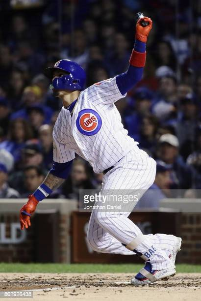 Javier Baez of the Chicago Cubs hits a home run in the fifth inning against the Los Angeles Dodgers during game four of the National League...