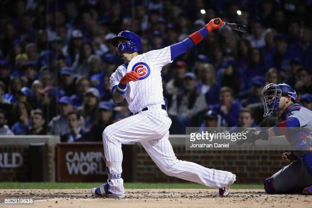 Javier Baez of the Chicago Cubs hits a home run in the second inning against the Los Angeles Dodgers during game four of the National League...