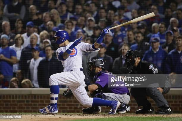 Javier Baez of the Chicago Cubs hits a RBI double in the eighth inning against the Colorado Rockies to score Terrance Gore during the National League...