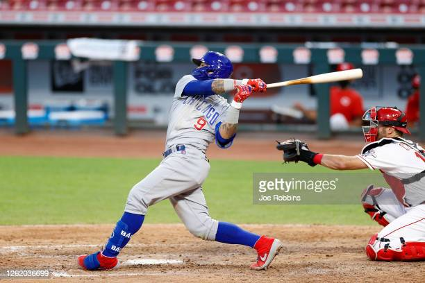 Javier Baez of the Chicago Cubs hits a solo home run in the seventh inning of the game against the Cincinnati Reds at Great American Ball Park on...