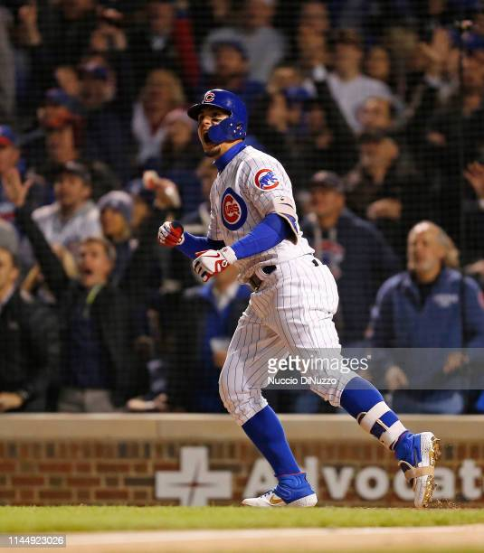 Javier Baez of the Chicago Cubs hits a three run home run against the Los Angeles Dodgers during the sixth inning of a game at Wrigley Field on April...