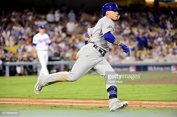 Javier Baez of the Chicago Cubs hits a threerun double in the eighth inning against the Los Angeles Dodgers in game five of the National League...