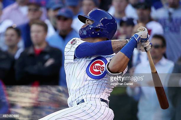 Javier Baez of the Chicago Cubs hits a threerun home run in the second inning against the St Louis Cardinals during game four of the National League...