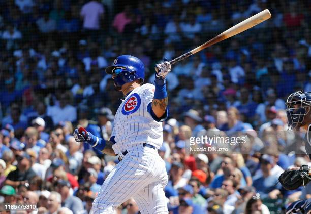 Javier Baez of the Chicago Cubs hits a two run home run during the third inning of a game against the Milwaukee Brewers at Wrigley Field on August 02...