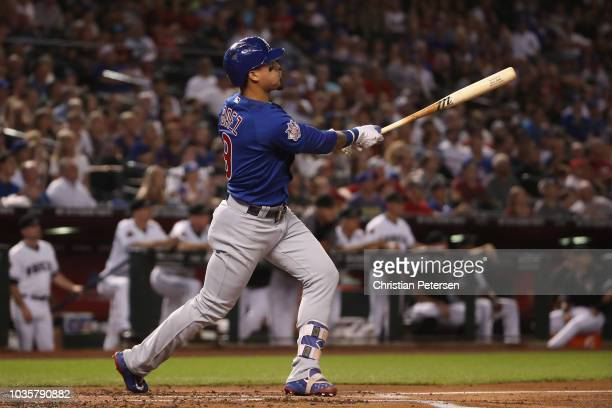 Javier Baez of the Chicago Cubs hits a tworun home run against the Arizona Diamondbacks during the first inning of the MLB game at Chase Field on...