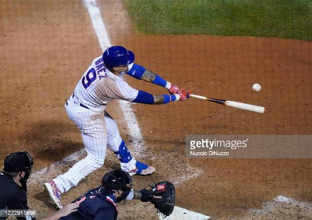 Javier Baez of the Chicago Cubs hits a walk off RBI single during the tenth inning of a game against the Cleveland Indians at Wrigley Field on...