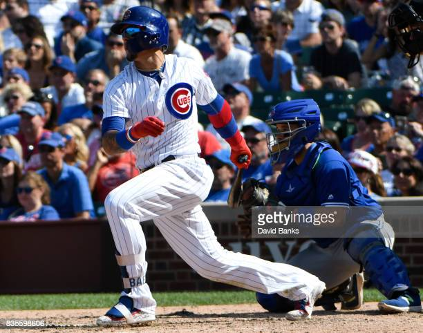 Javier Baez of the Chicago Cubs hits an RBI single against the Toronto Blue Jays during the sixth inning on August 19 2017 at Wrigley Field in...