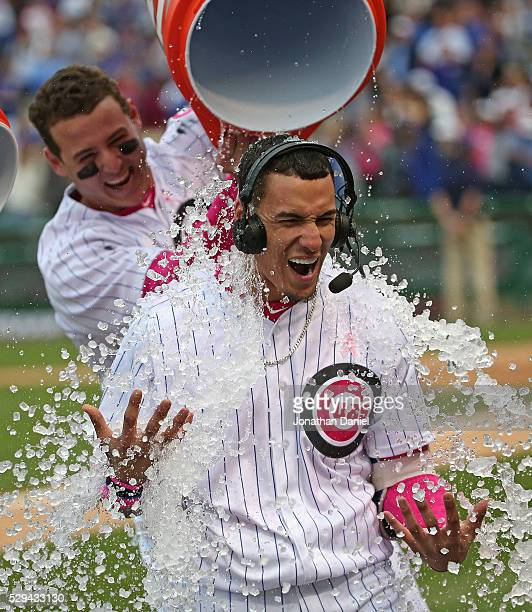 Javier Baez of the Chicago Cubs is doused with water by Anthony Rizzo after hitting a gamewinning walk off home run against the Washington Nationals...