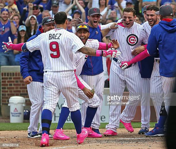 Javier Baez of the Chicago Cubs is greeted by teammates after hitting the gamewinning walk off home run against the Washington Nationals at Wrigley...