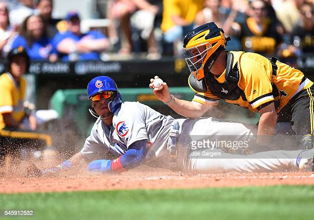 Javier Baez of the Chicago Cubs is tagged out at home plate by Eric Fryer of the Pittsburgh Pirates during the fifth inning on July 10 2016 at PNC...