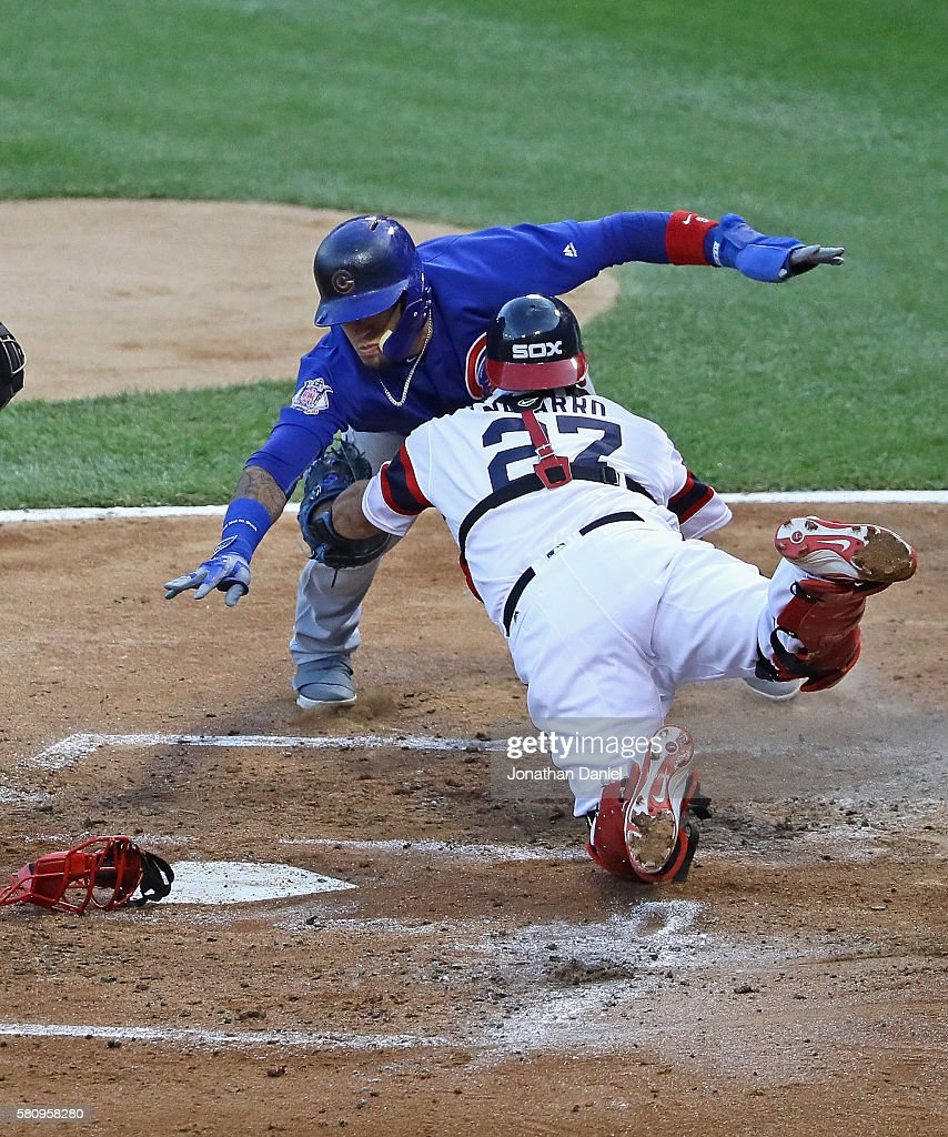 Javier Baez #9 of the Chicago Cubs is tagged out trying to reach for the plate by Dioner Navarro #27 of the Chicago White Sox in the 3rd inning at U.S. Cellular Field on July 25, 2016 in Chicago, Illinois.