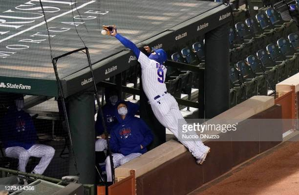 Javier Baez of the Chicago Cubs is unable to catch the foul ball by Byron Buxton of the Minnesota Twins during the ninth inning of a game at Wrigley...