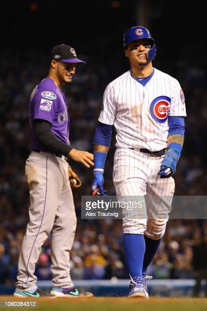 Javier Baez of the Chicago Cubs looks on during the National League Wild Card game against the Colorado Rockies at Wrigley Field on Tuesday, October...