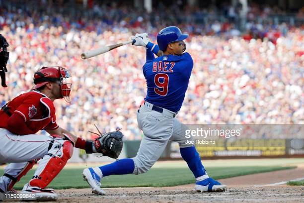 Javier Baez of the Chicago Cubs looks up as he hits a grand slam home run against the Cincinnati Reds in the eighth inning at Great American Ball...