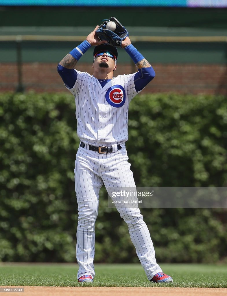 Javier Baez #9 of the Chicago Cubs makes a catch against the San Francisco Giants at Wrigley Field on May 25, 2018 in Chicago, Illinois. The Cubs defeated the Giants 6-2.