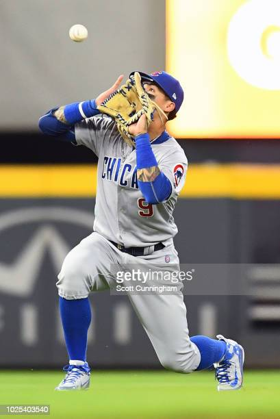 Javier Baez of the Chicago Cubs makes a catch in the ninth inning against the Atlanta Braves at SunTrust Park on August 30 2018 in Atlanta Georgia