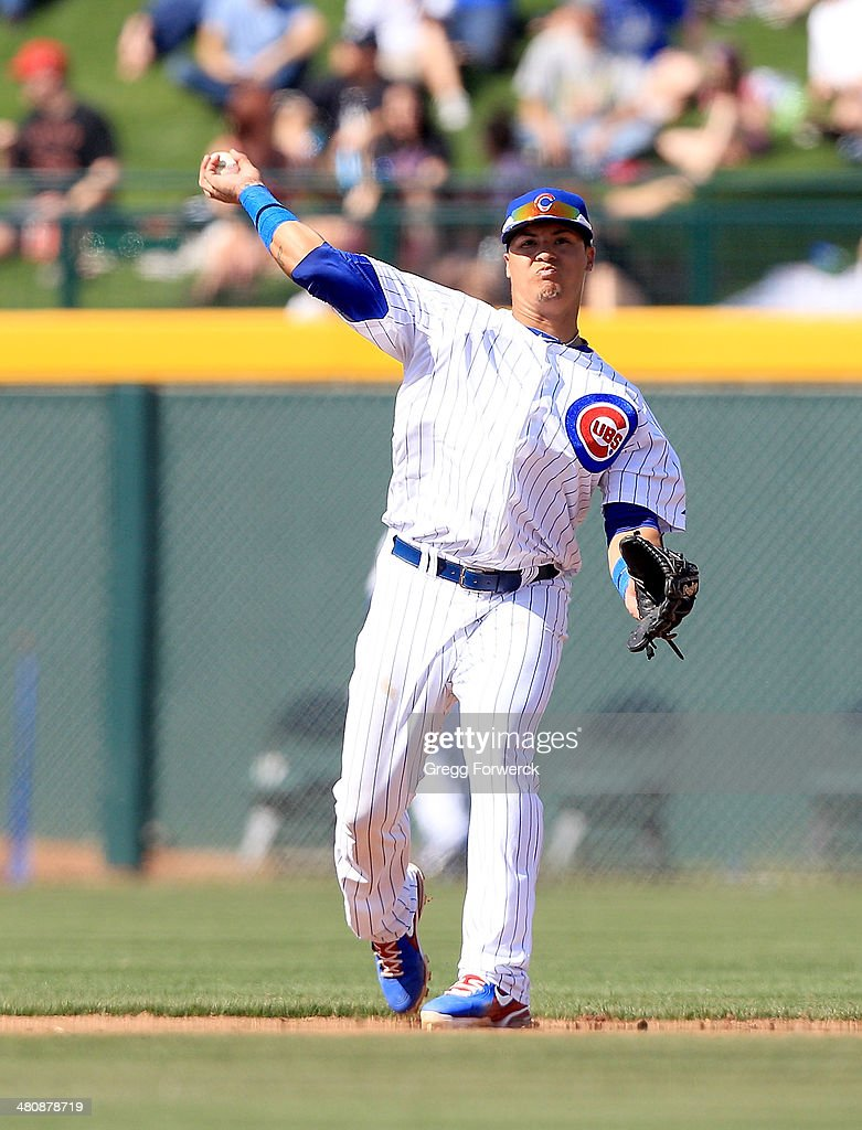 Javier Baez #70 of the Chicago Cubs plays defense against the Cleveland Indians during a spring training baseball game at Cubs Park on March 7, 2014 in Mesa, Arizona.