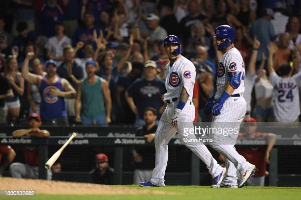 Javier Baez of the Chicago Cubs reacts after his walk off single in the ninth inning against the Cincinnati Reds at Wrigley Field on July 26, 2021 in...