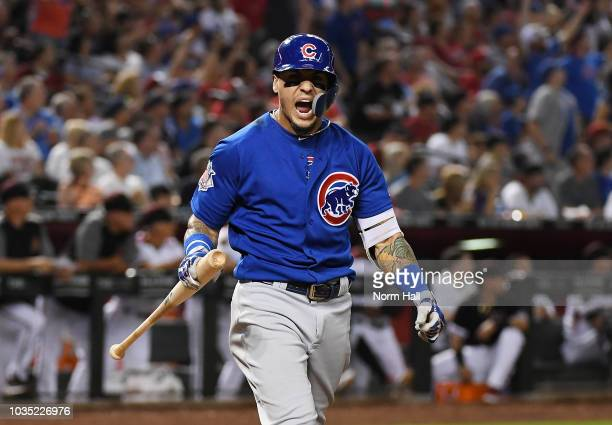 Javier Baez of the Chicago Cubs reacts after hitting a two run home run during the sixth inning against the Arizona Diamondbacks at Chase Field on...