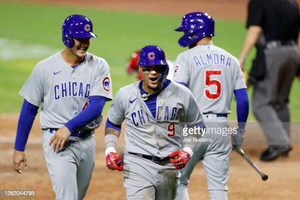Javier Baez of the Chicago Cubs reacts after hitting a two-run home run in the ninth inning against the Cincinnati Reds at Great American Ball Park...