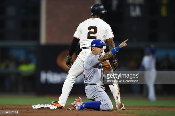 Javier Baez of the Chicago Cubs reacts after tagging out Denard Span of the San Francisco Giants attempting to steal second base in the third inning...