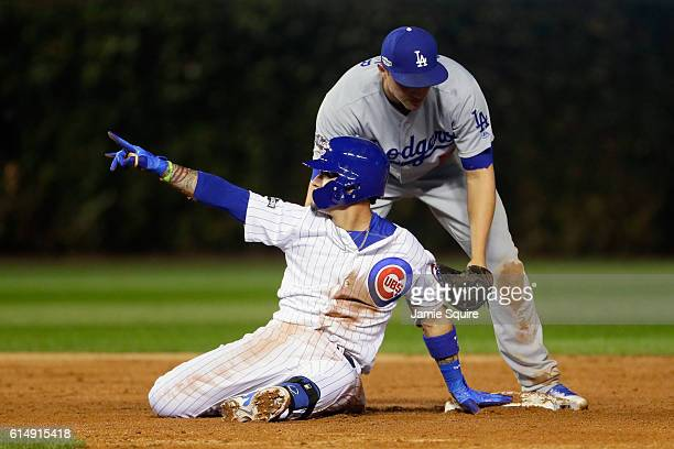 Javier Baez of the Chicago Cubs reacts at second base after hitting an RBI double to score Jason Heyward in the second inning against the Los Angeles...