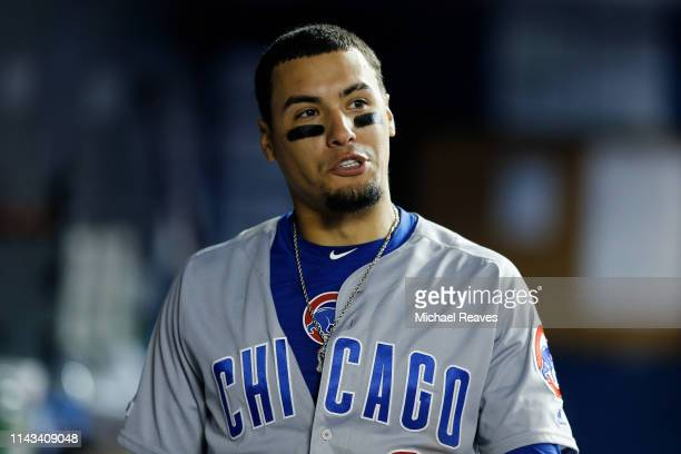 Javier Baez of the Chicago Cubs reacts in the dugout against the Miami Marlins at Marlins Park on April 16 2019 in Miami Florida