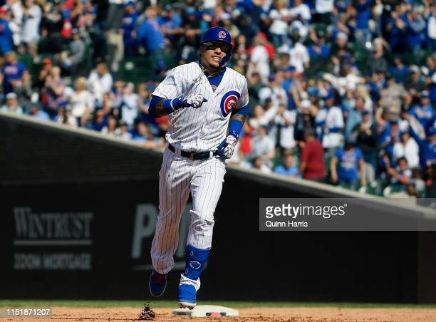 Javier Baez of the Chicago Cubs reacts rounding bases after hitting a solo home run in the eight inning against the Cincinnati Reds at Wrigley Field...