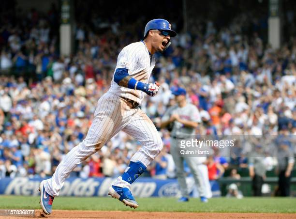 Javier Baez of the Chicago Cubs reacts rounding the bases after hitting a three run home run in the eight inning against the New York Mets at Wrigley...