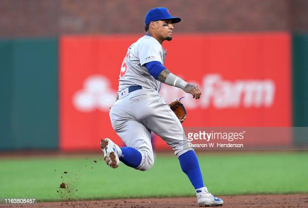 Javier Baez of the Chicago Cubs reacts to field a ground ball up the middle against the San Francisco Giants in the bottom of the third inning at...