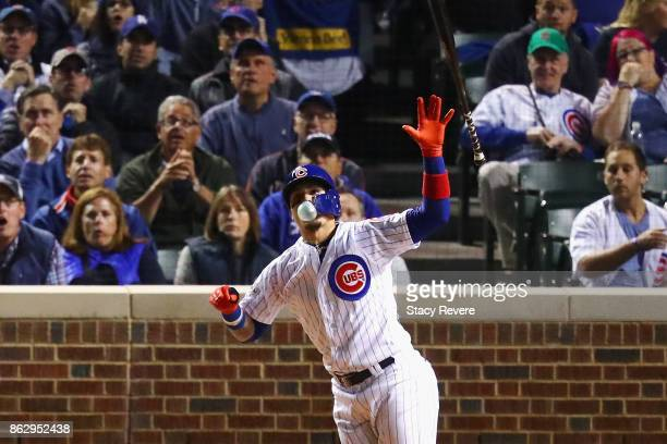 Javier Baez of the Chicago Cubs reacts to hitting a home run in the fifth inning against the Los Angeles Dodgers during game four of the National...