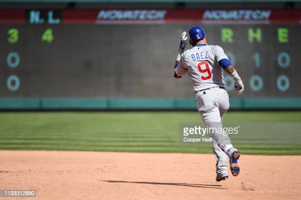 Javier Baez of the Chicago Cubs rounds the bases after hitting a home run in the fourth inning during the game between the Chicago Cubs and the Texas...