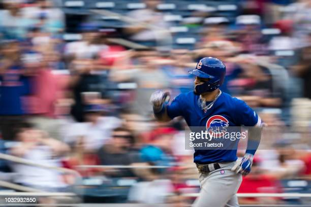 Javier Baez of the Chicago Cubs rounds the bases after hitting a solo home run against the Washington Nationals during the sixth inning at Nationals...