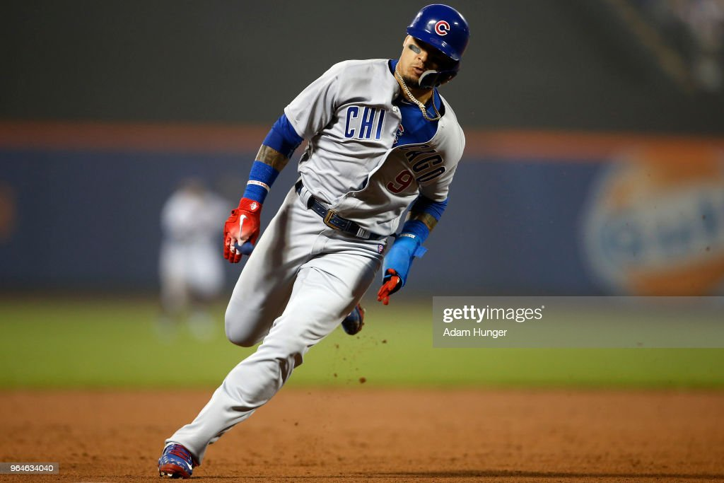 Javier Baez #9 of the Chicago Cubs rounds third base to score a run against the New York Mets during the sixth inning at Citi Field on May 31, 2018 in the Flushing neighborhood of the Queens borough of New York City.