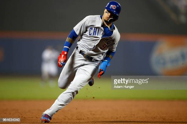 Javier Baez of the Chicago Cubs rounds third base to score a run against the New York Mets during the sixth inning at Citi Field on May 31 2018 in...