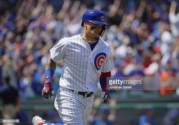 Javier Baez of the Chicago Cubs runs the bases after hitting a grand slam home run in the 1st inning against the Cincinnati Reds at Wrigley Field on...