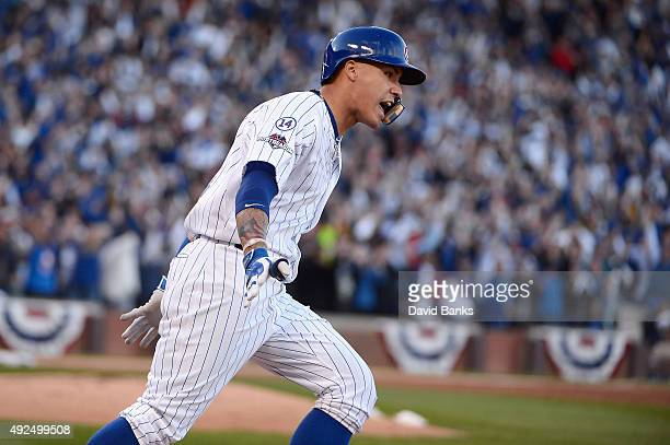 Javier Baez of the Chicago Cubs runs the bases after hitting a threerun home run in the second inning against the St Louis Cardinals during game four...