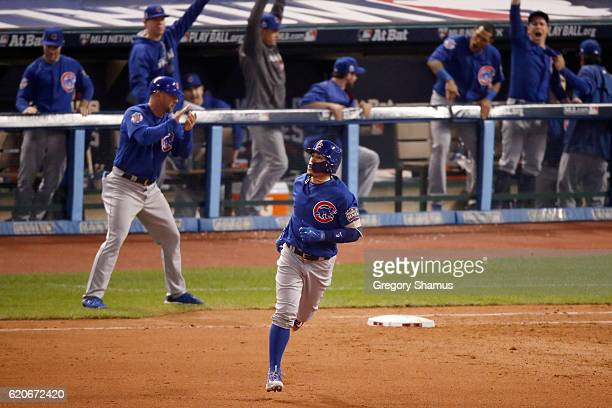 Javier Baez of the Chicago Cubs runs the bases after hitting a solo home run during the fifth inning against the Cleveland Indians in Game Seven of...