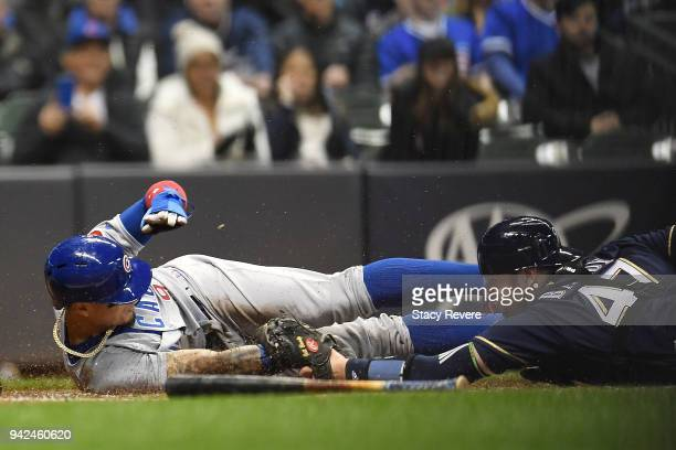 Javier Baez of the Chicago Cubs scores during the second inning of a game against Jeff Bandy of the Milwaukee Brewers at Miller Park on April 5 2018...