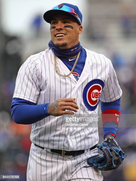 Javier Baez of the Chicago Cubs smiles at fans as he runs off the field during the Opening Day home game against the Pittsburgh Pirates at Wrigley...